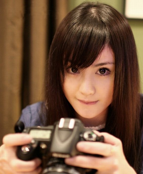 Девушек с фотоаппаратами 26 фото