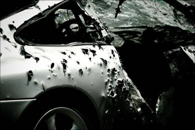Американец изрешетил свой Porsche! (7 фото)
