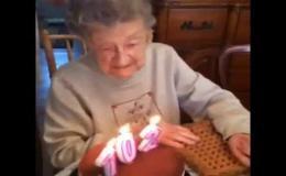 Бабуля задувает свечки на свой 102 день рождения