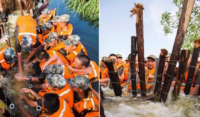 Китайские солдаты сделали плотину из своих тел, что бы не допустить наводне ...