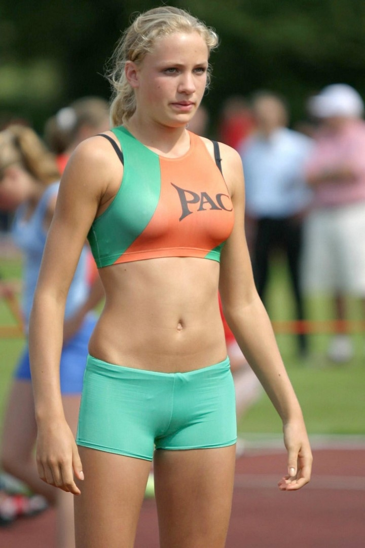 Young Girl In Sportswear In A Gym In A Simple Background, A Theme Of Fitness, And Sport