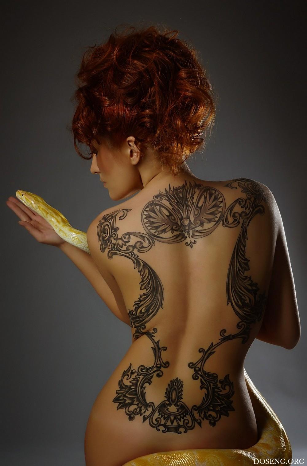 Фото тату на женской спине