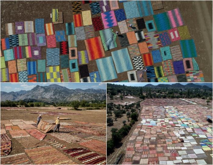 Тысячи ковров ручной работы выгорают на поле под солнцем в Турции